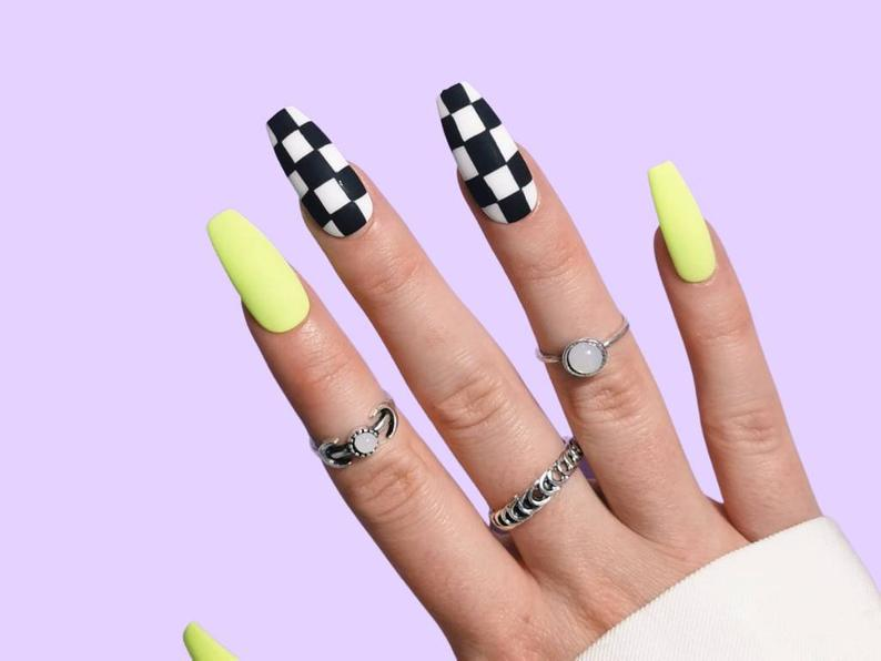 Lime green and checkered almond nails