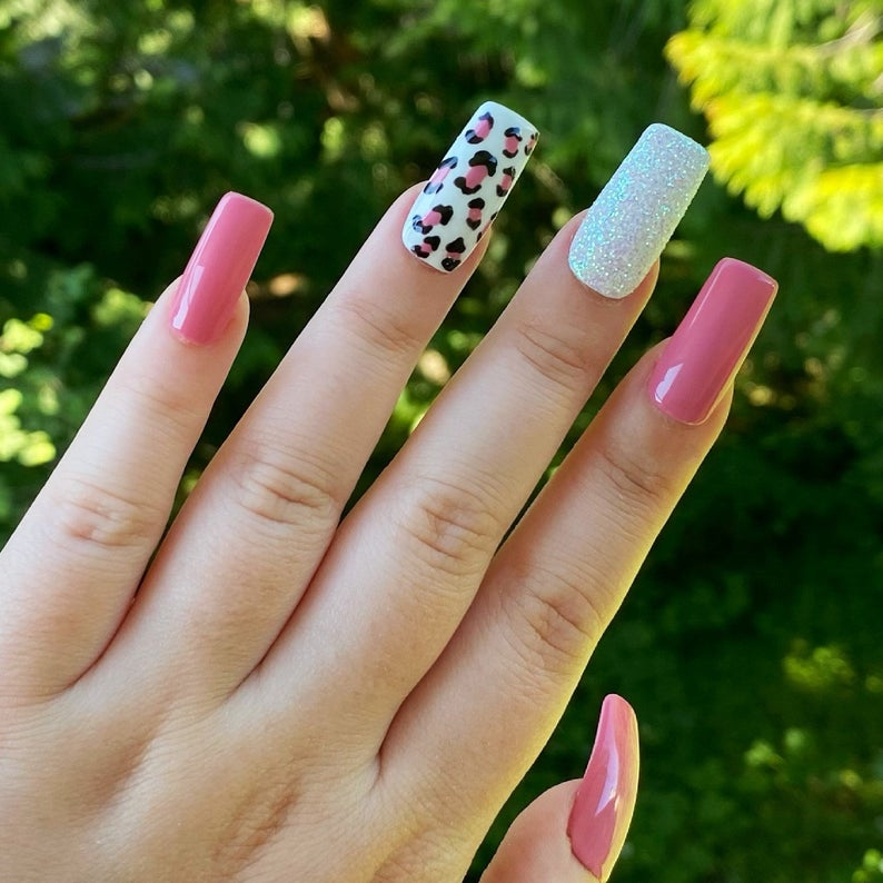 Solid pink nails with leopard prints and glitter