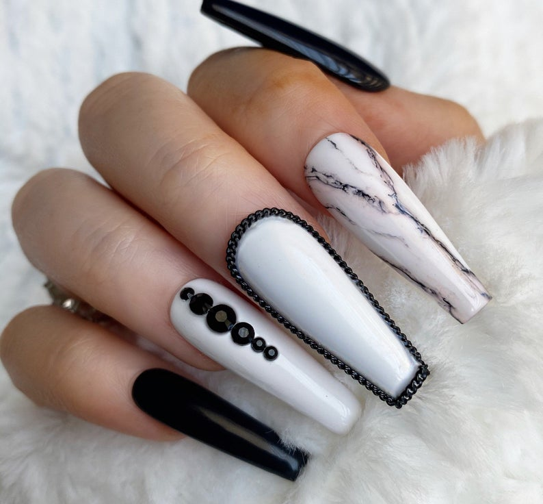 Black and white nails with marble and rhinestones