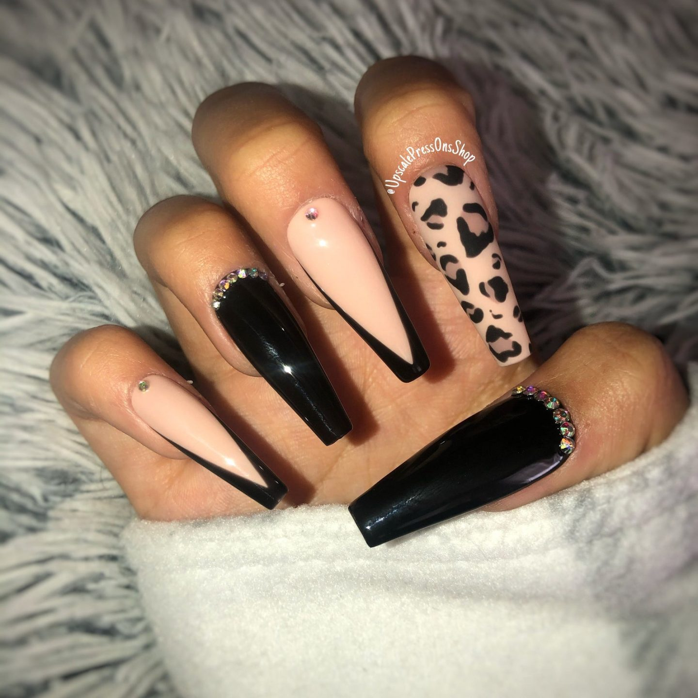 Black French tip nails with leopard print