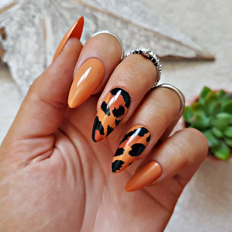 Burnt orange leopard print nails in almond shape