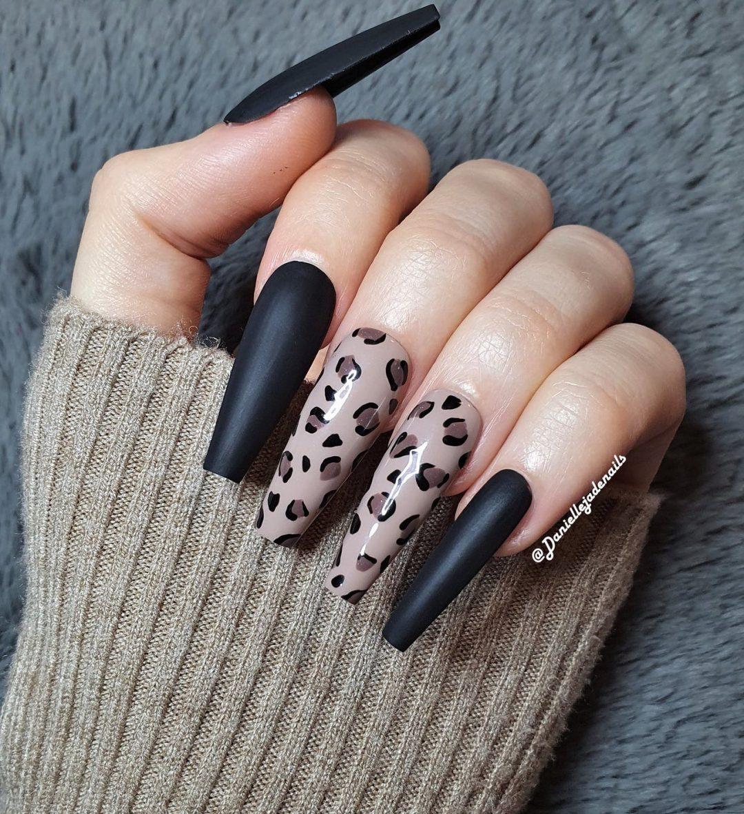 Matte black coffin nails with leopard print nail art
