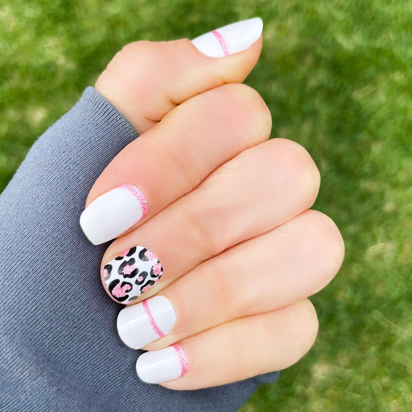 White nail wraps with pink leopard print and glitter