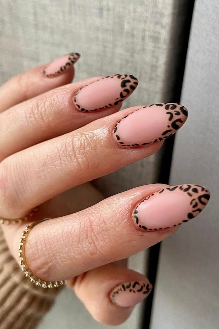Short French tip leopard print nails