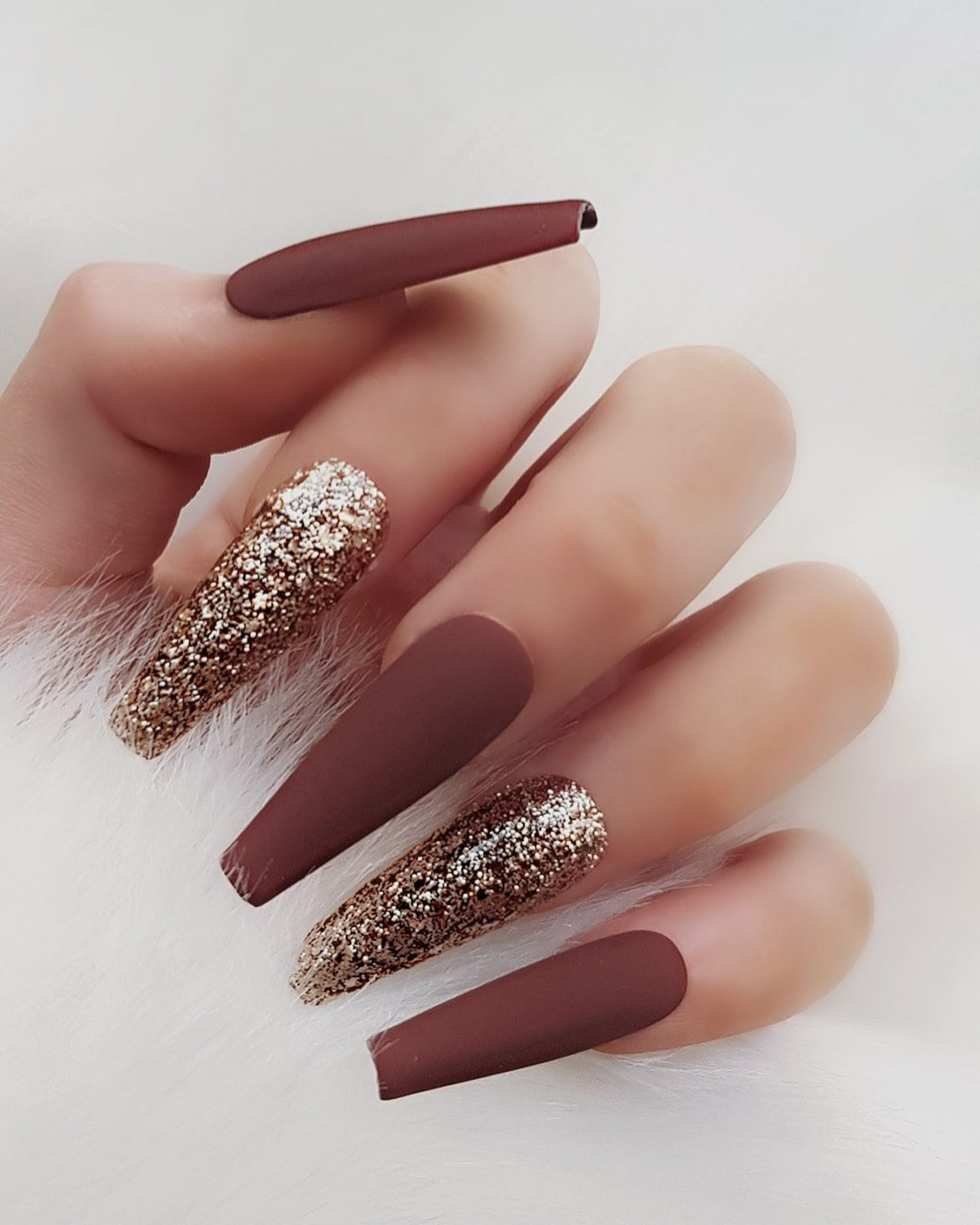 Matte brown nails with gold glitter