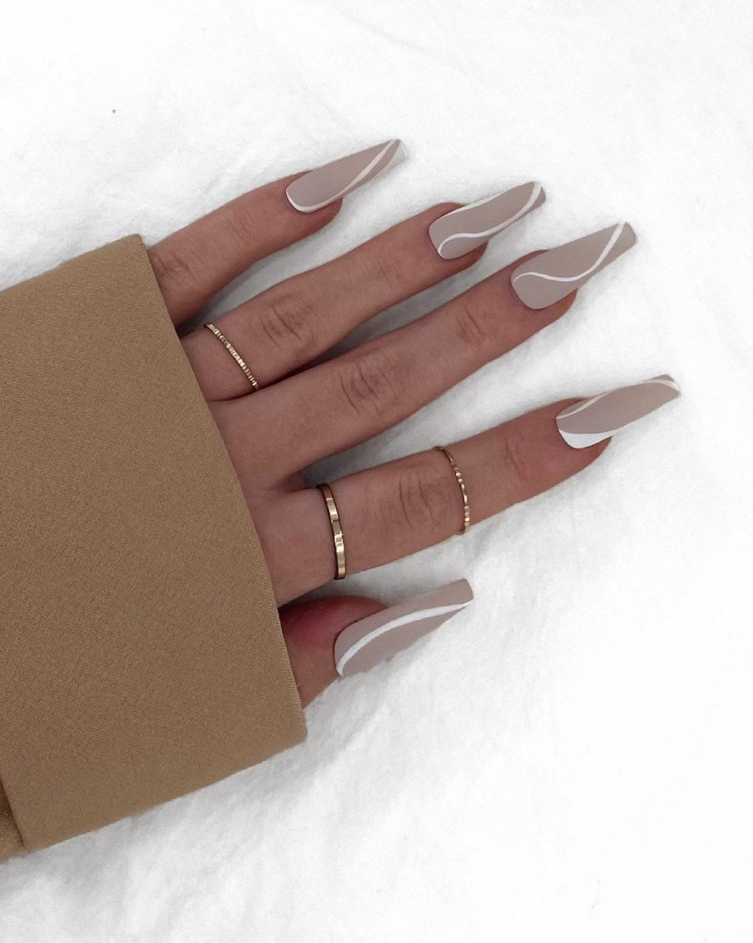 Matte nude nails with white lines