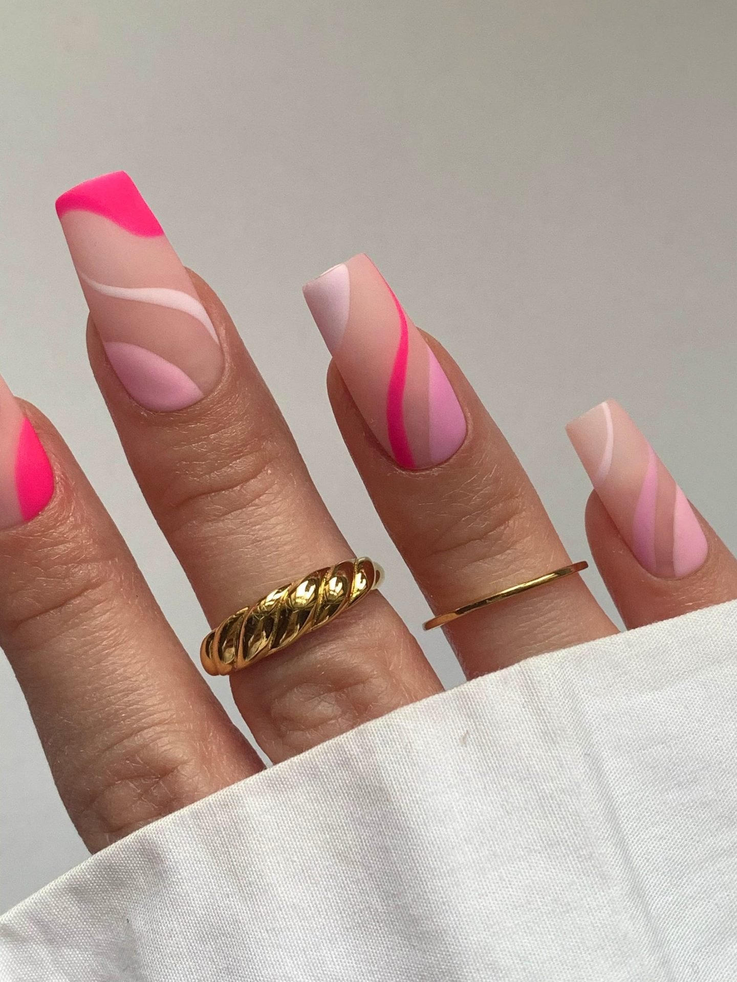Pink abstract nails with swirls
