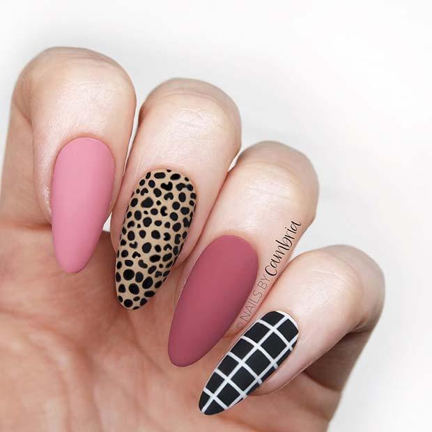 Matte pink and black leopard nails
