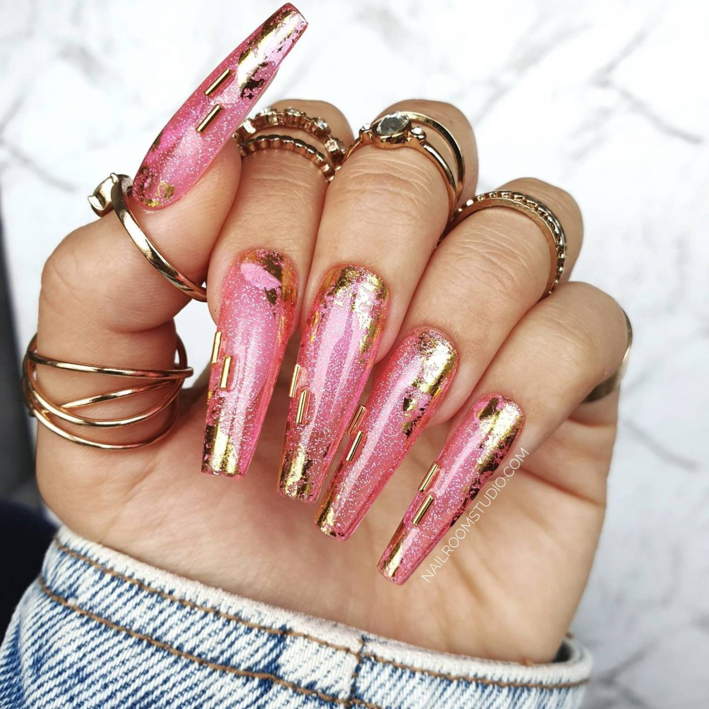Long pink coffin nails with jelly effect and gold foil