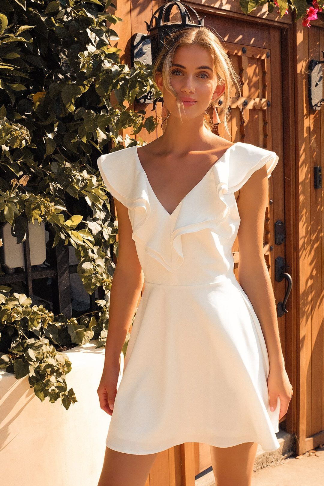 Casual white skater dress with ruffles for summer