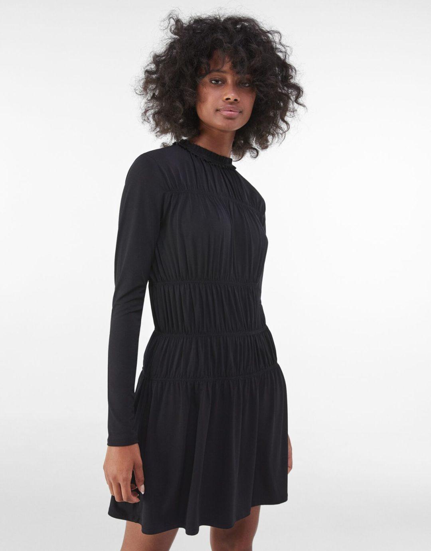 Black turtleneck dress with long sleeves