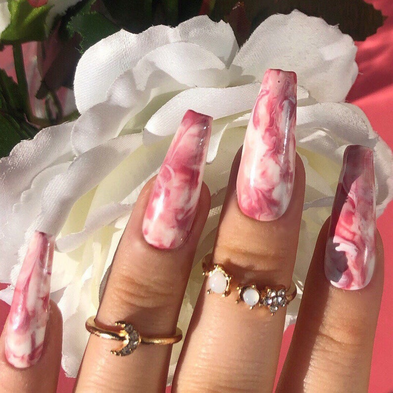 White and pink tie dye marble nails