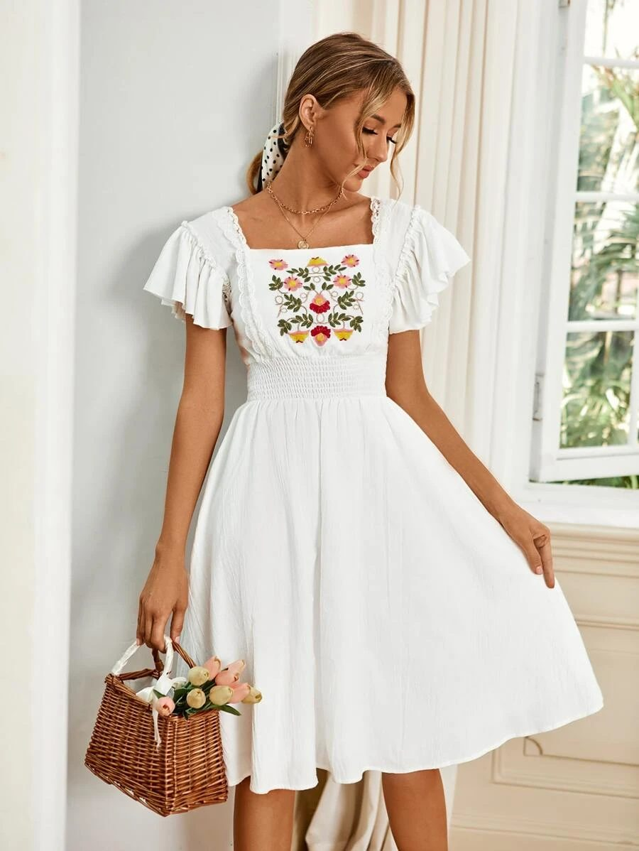 White cottagecore dress with floral embroidery, white milkmaid dress