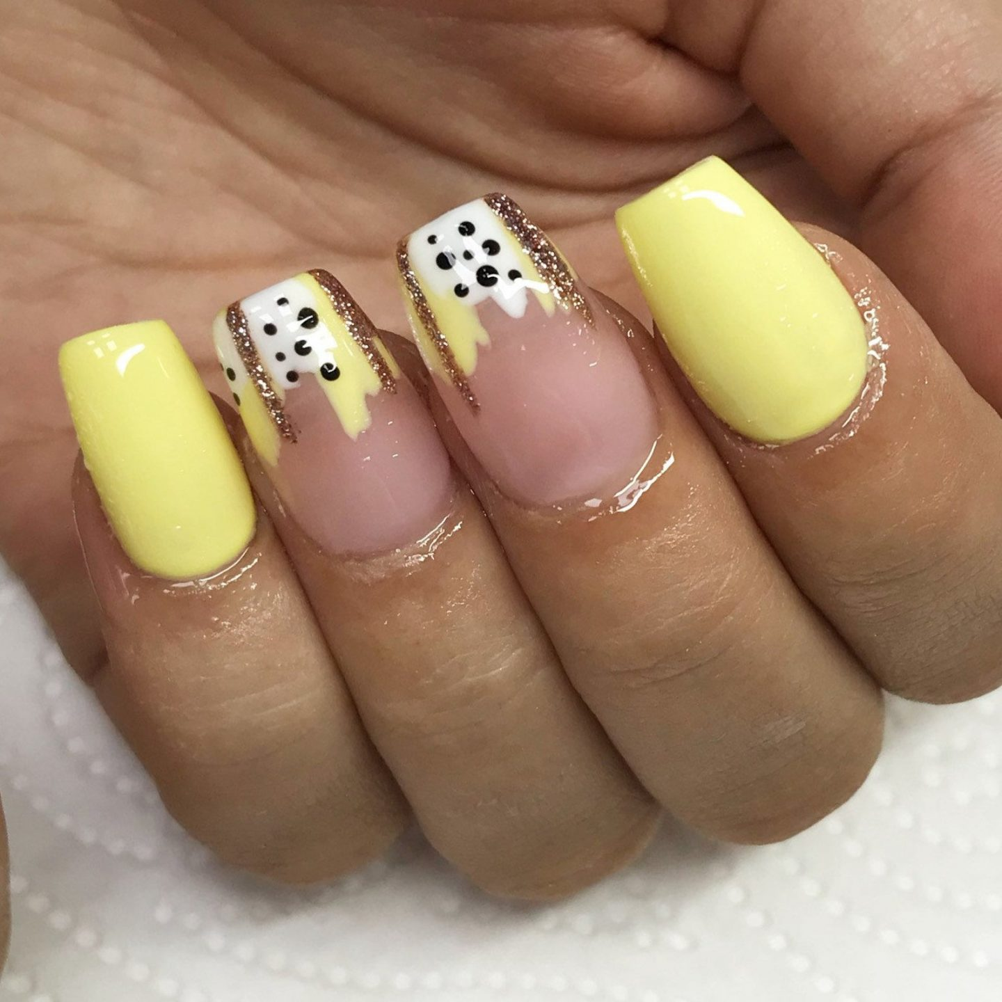 Cute pale yellow abstract nails
