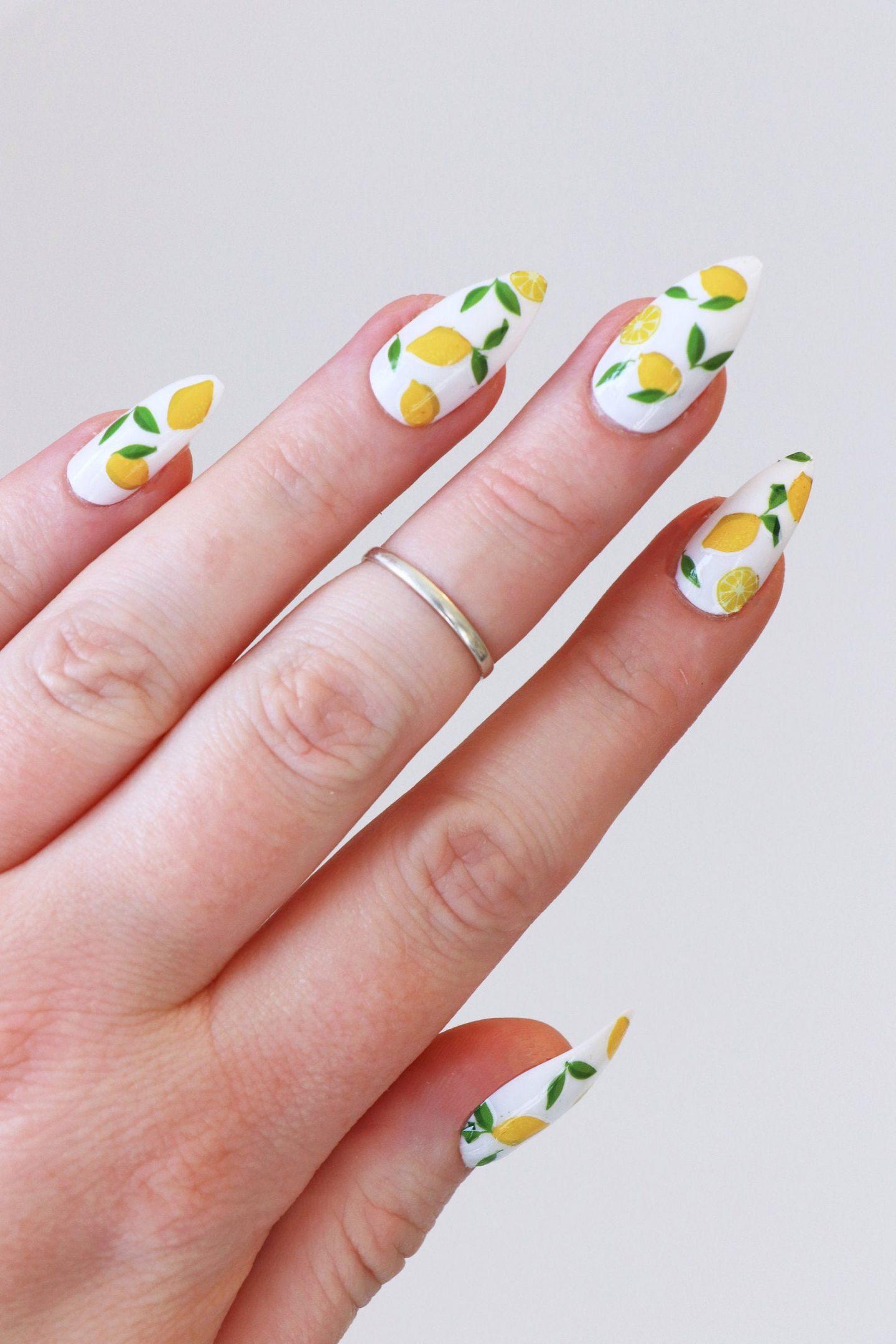 Lemon print nail design