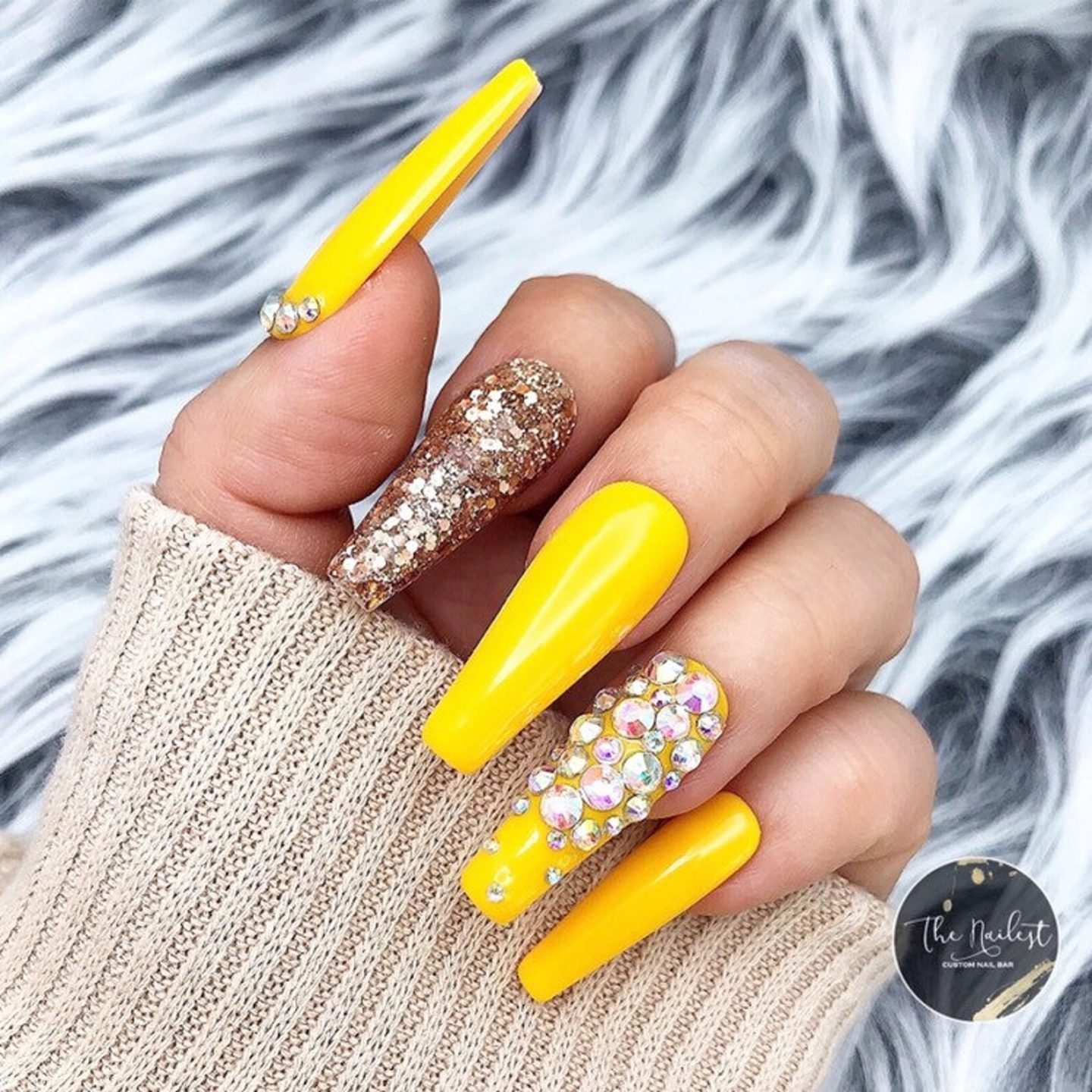 Yellow and gold nails with rhinestones and glitter
