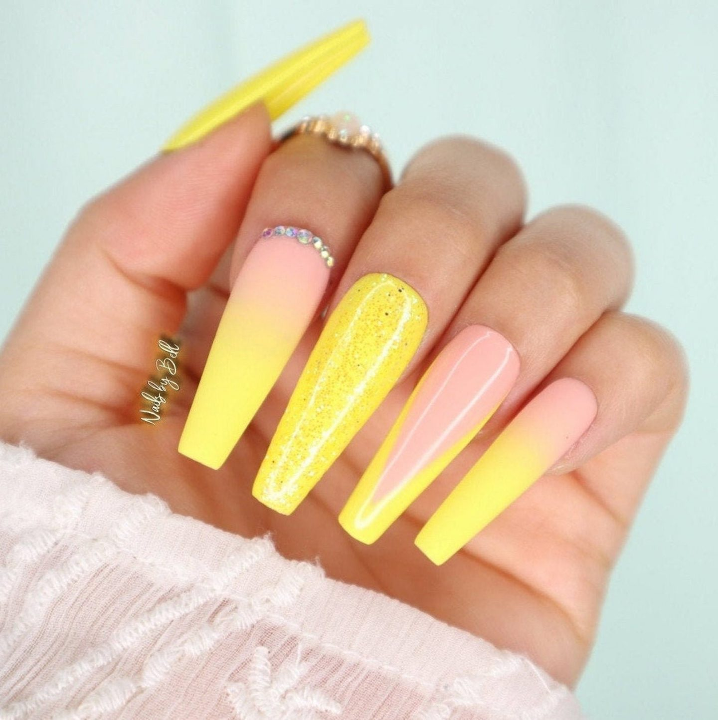 Yellow ombre French tip nails with glitter