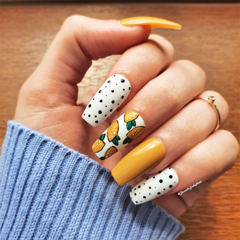 Yellow lemon print nails with black and white polka dots