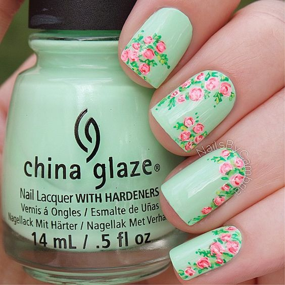 Mint green nails with pink roses