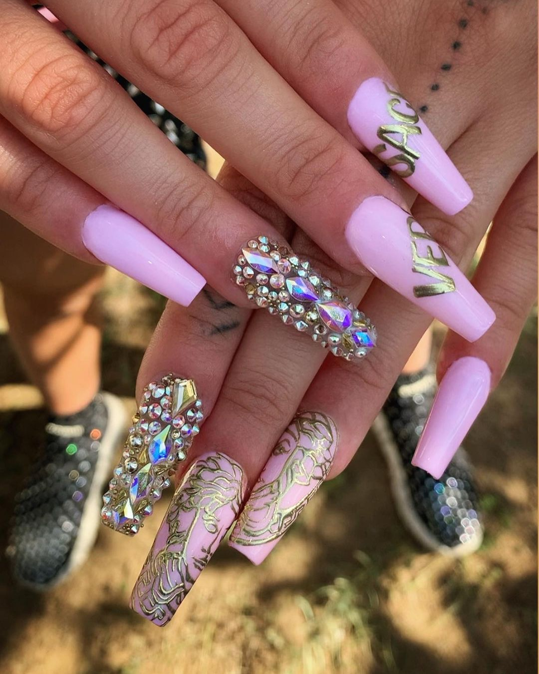 Soft pink and gold nails with rhinestones