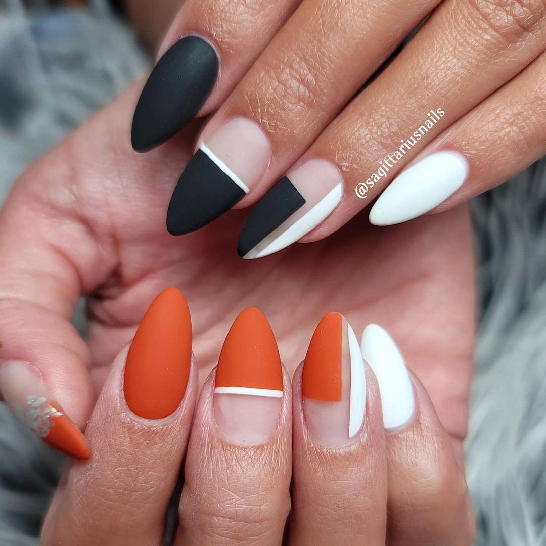 Matte burnt orange and black nails