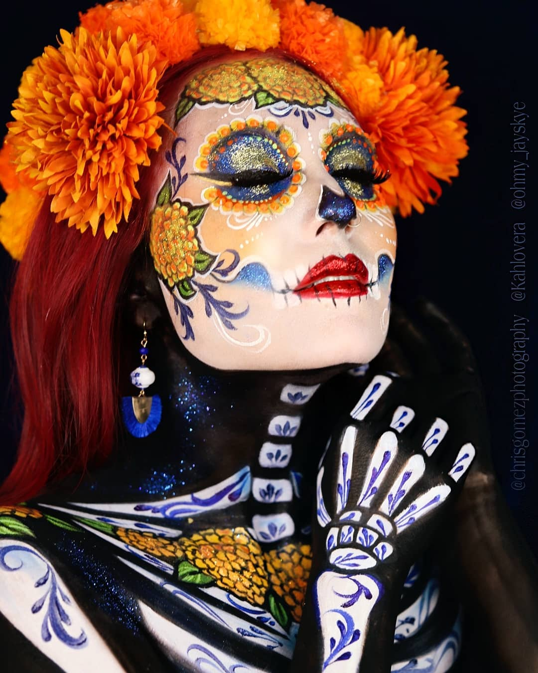 Orange flowers on hair and orange accents on sugar skull for Day of The Dead Makeup Ideas