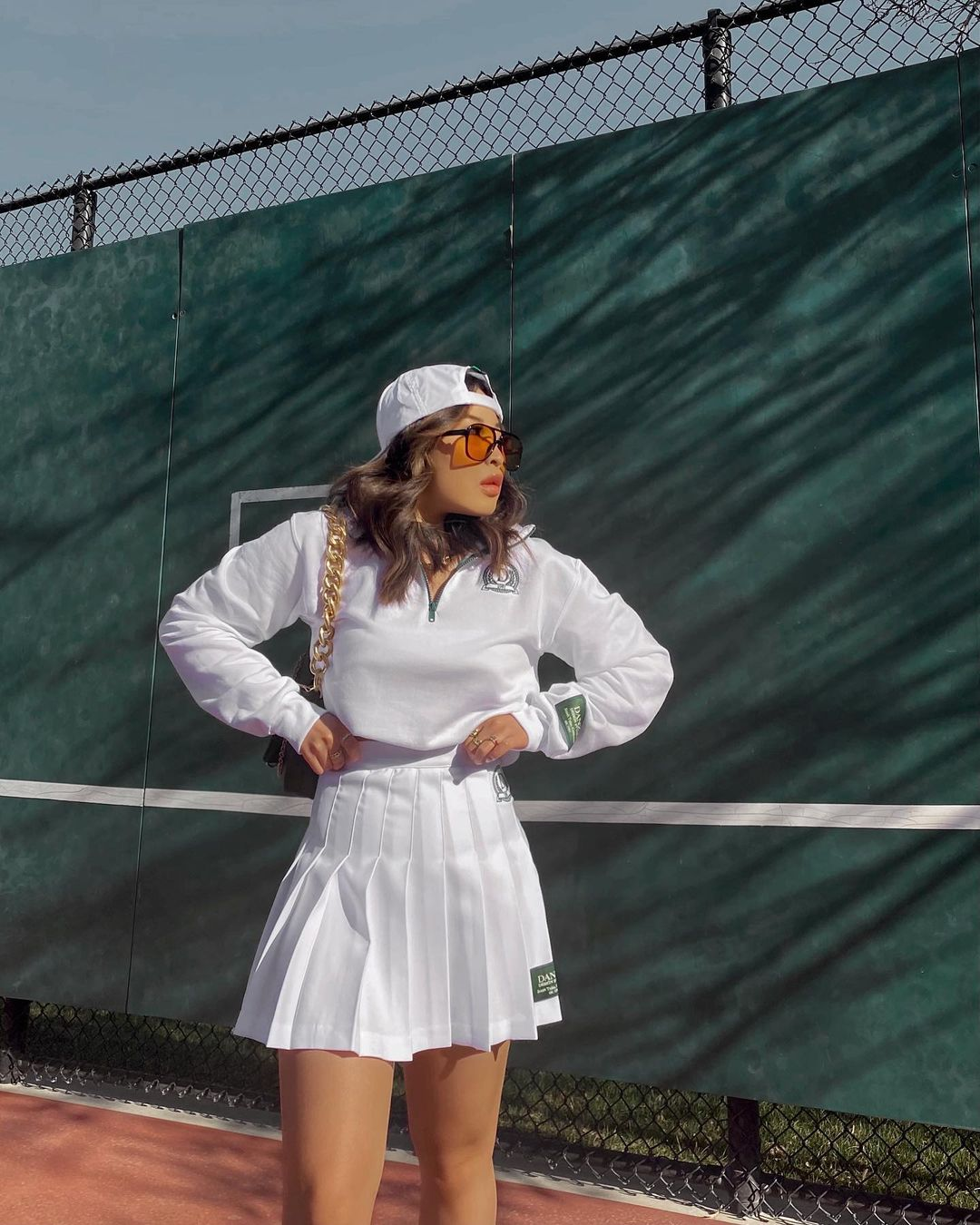Cropped white hoodie with pleated skirt for best outfits with hoodies