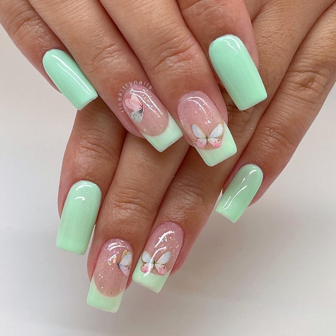 Mint green nails with butterflies and glitter