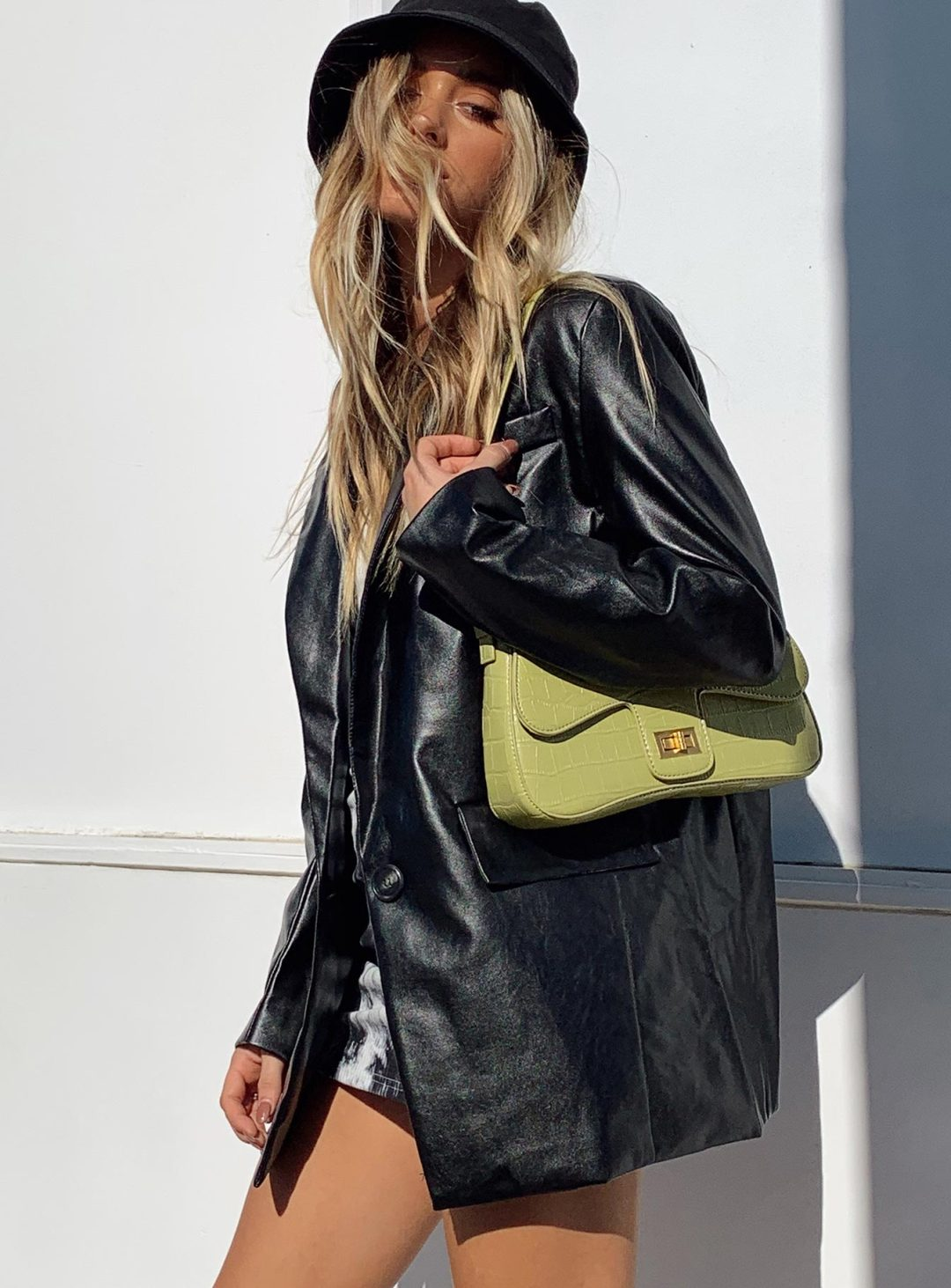 Black leather coat outfit with bucket hat