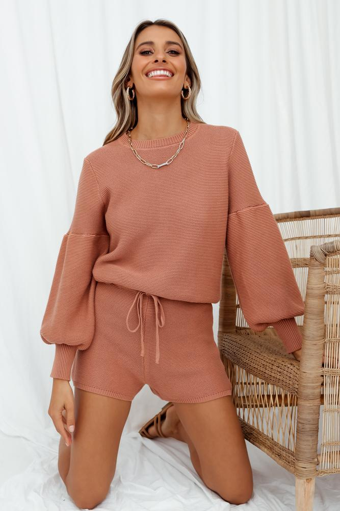 Tan colored loose shorts and sweater to wear after self tanning