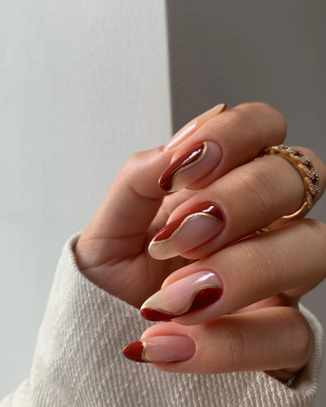 Swirly brown and gold abstract nails with negative space