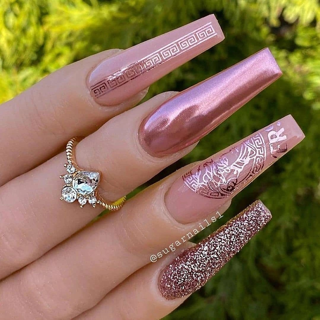Rose pink chrome nails with glitter