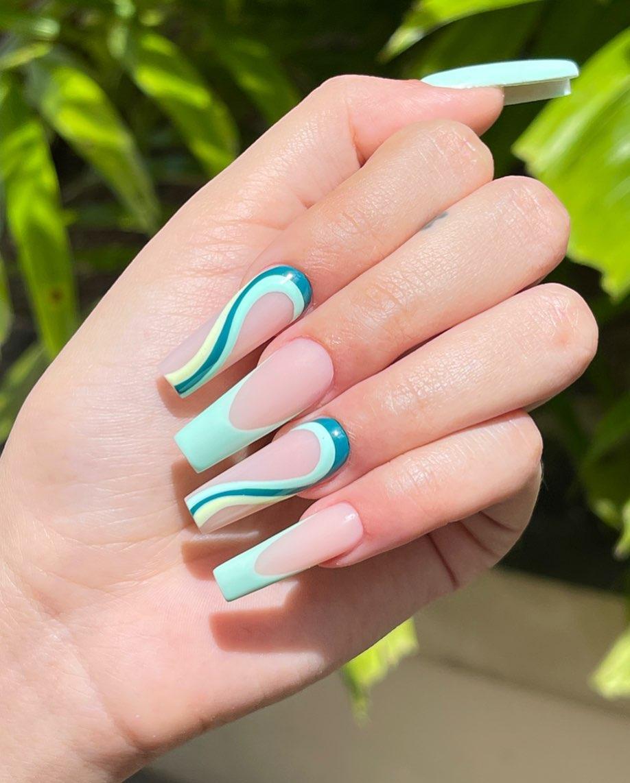 Mint green swirly nails
