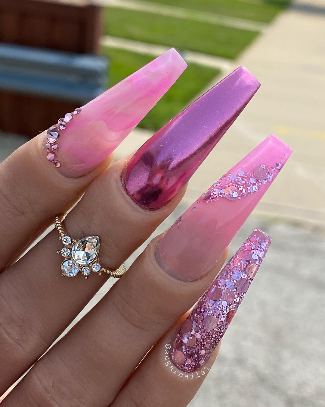 Pink chrome nails with glitter and rhinestones