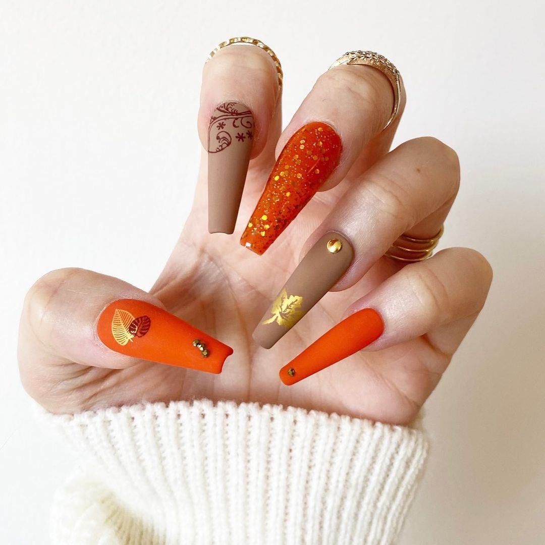 Burnt orange nails with brown matte and glitter