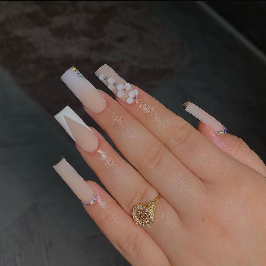 Nude matte prom nails with flower decals