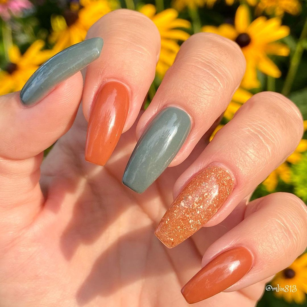 Burnt orange and sage green nails with glitter