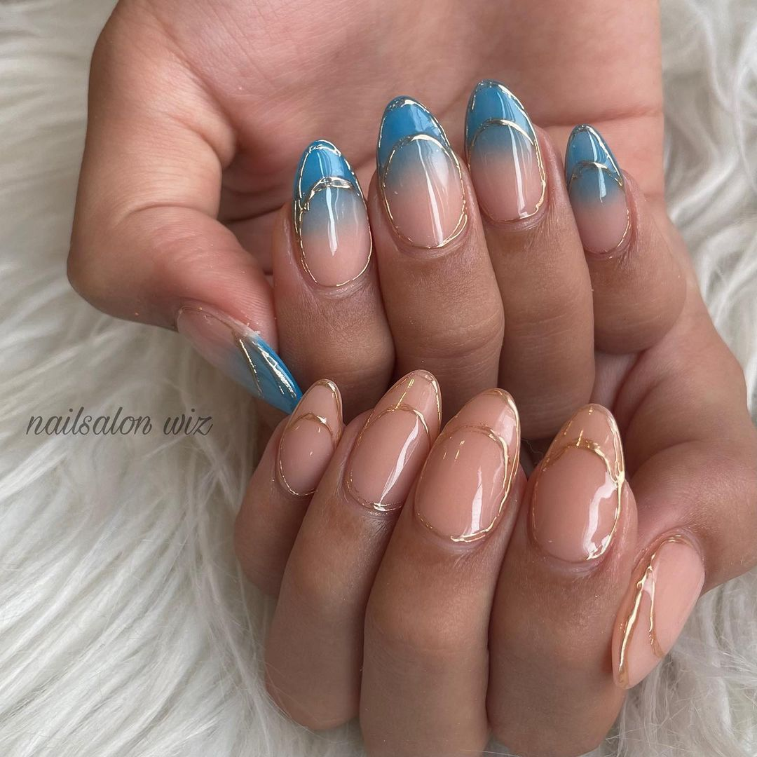 Blue and nude ombre nails with gold detailing