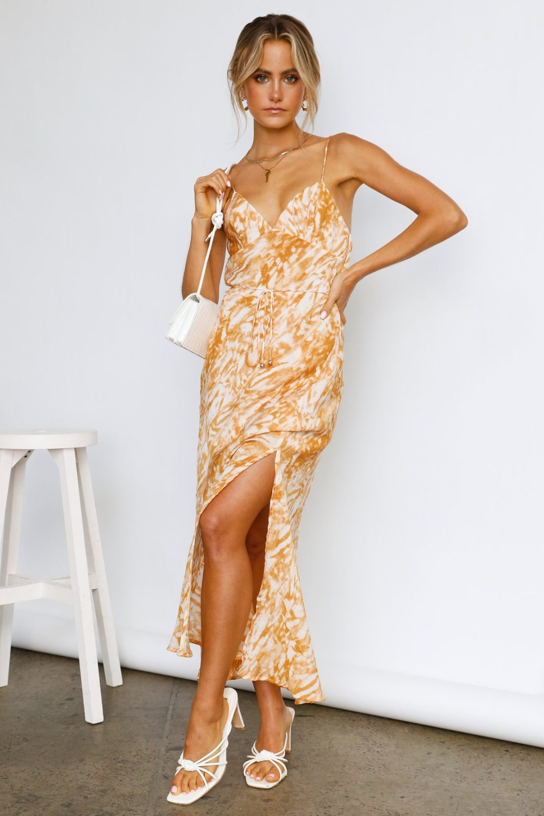 Patterned orange maxi dress with high slit