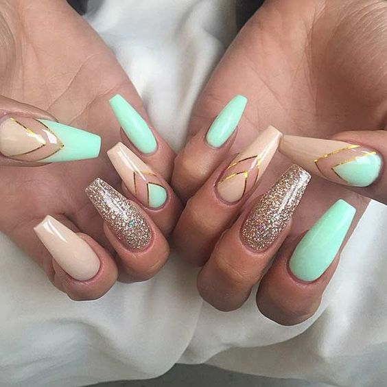 Mint green nails with nude polish and gold glitter