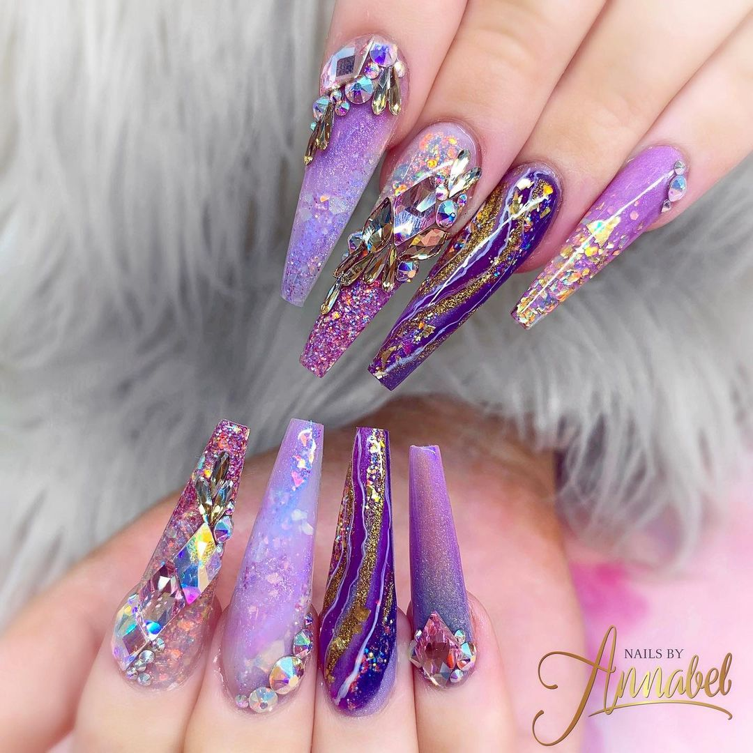 Purple nails with glitter and rhinestones