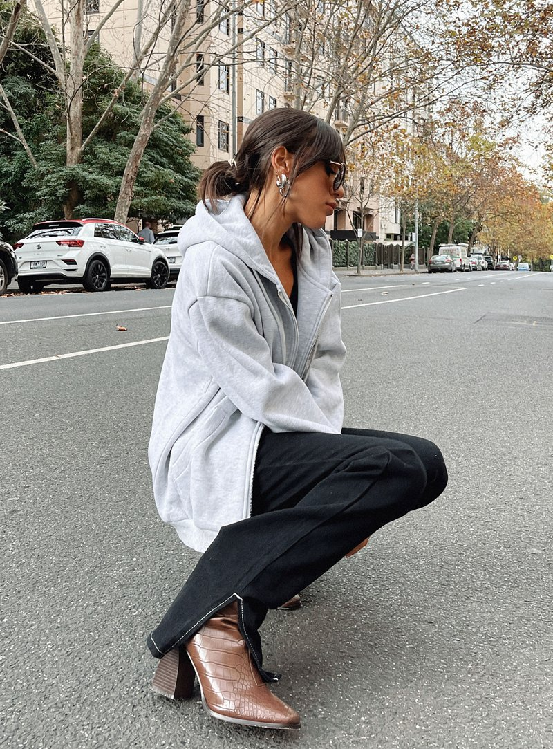 Gray zip-up hoodie with pants and boots for best outfits with hoodies