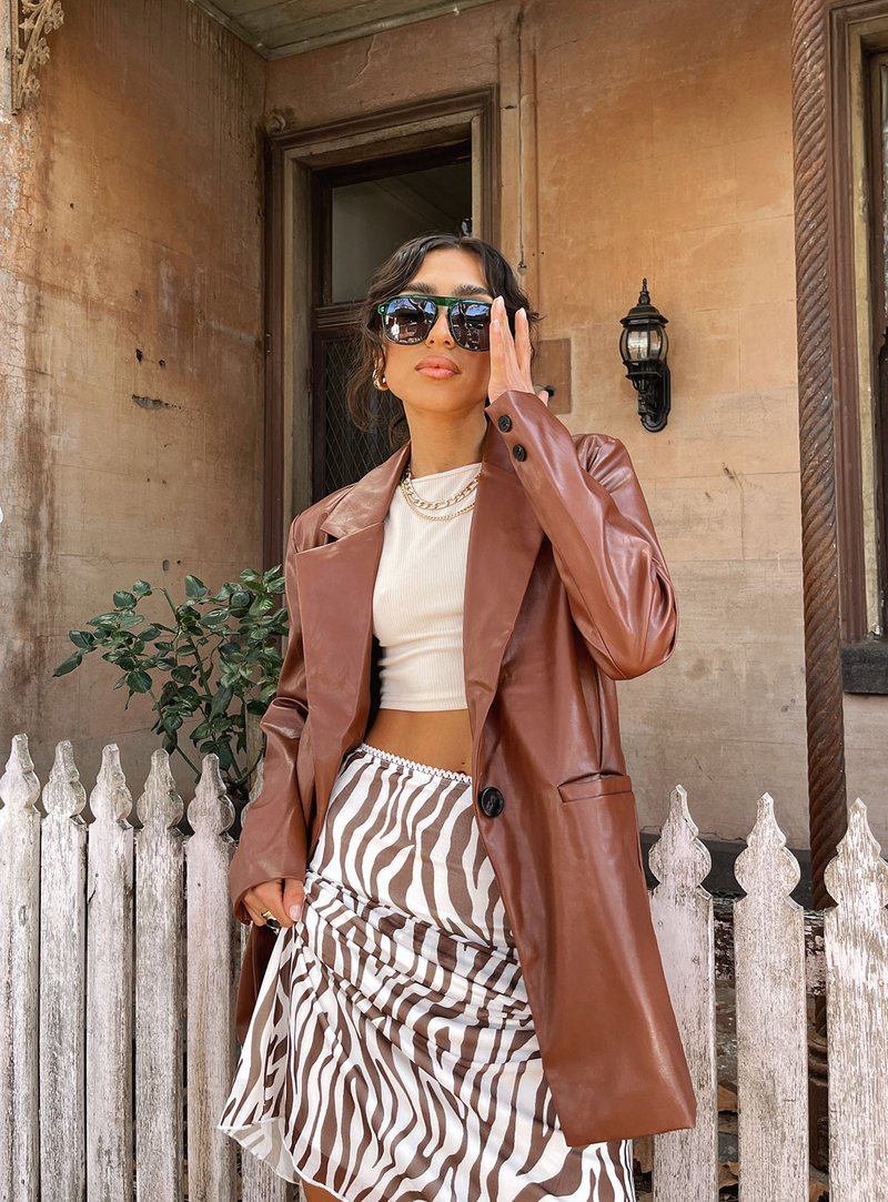 Brown leather coat with zebra print skirt