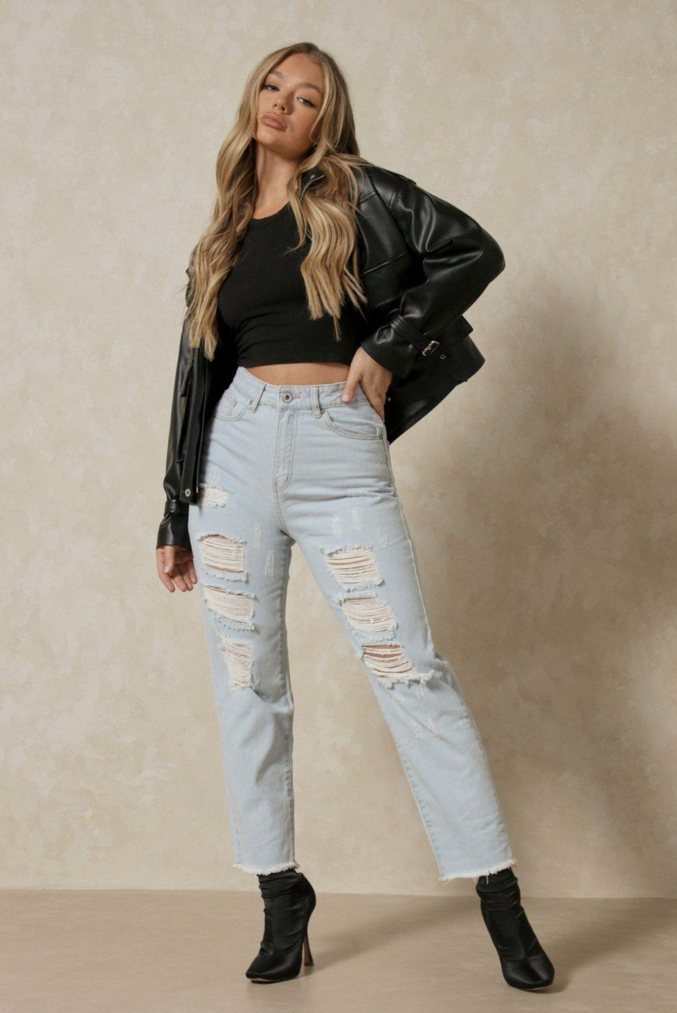 Light ripped mom jeans with black leather jacket