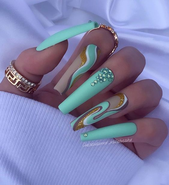 Mint green and gold glitter swirly nails