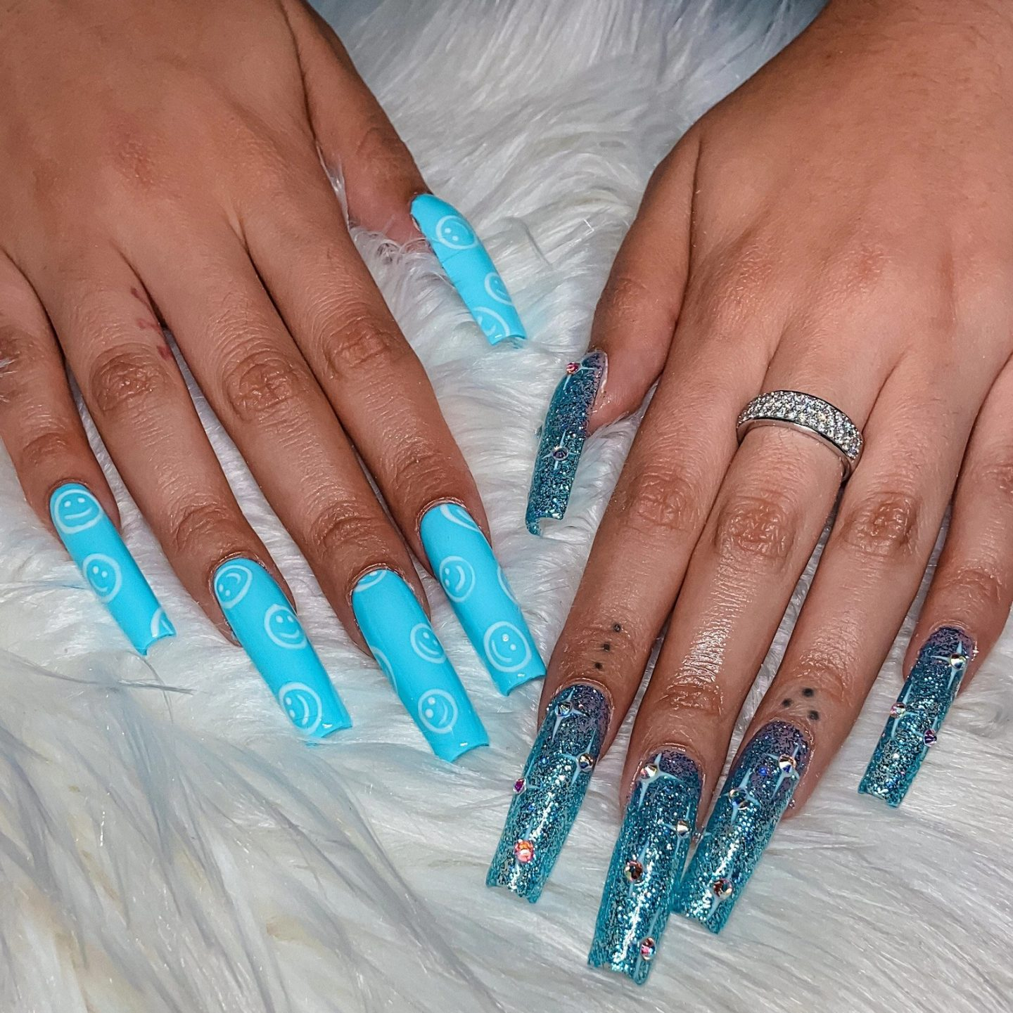 Icy blue coffin nails with smiley faces