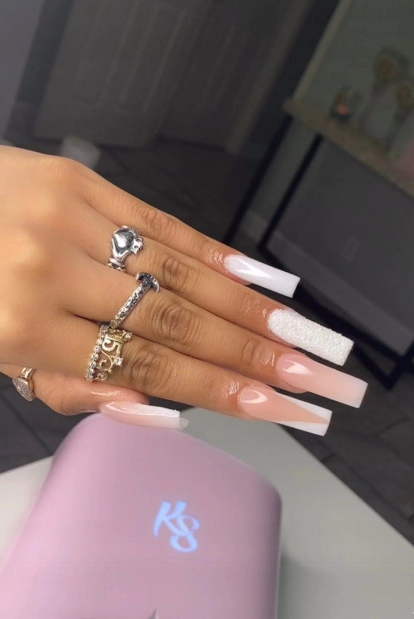 Glamorous white and French tip birthday nails with rhinestones