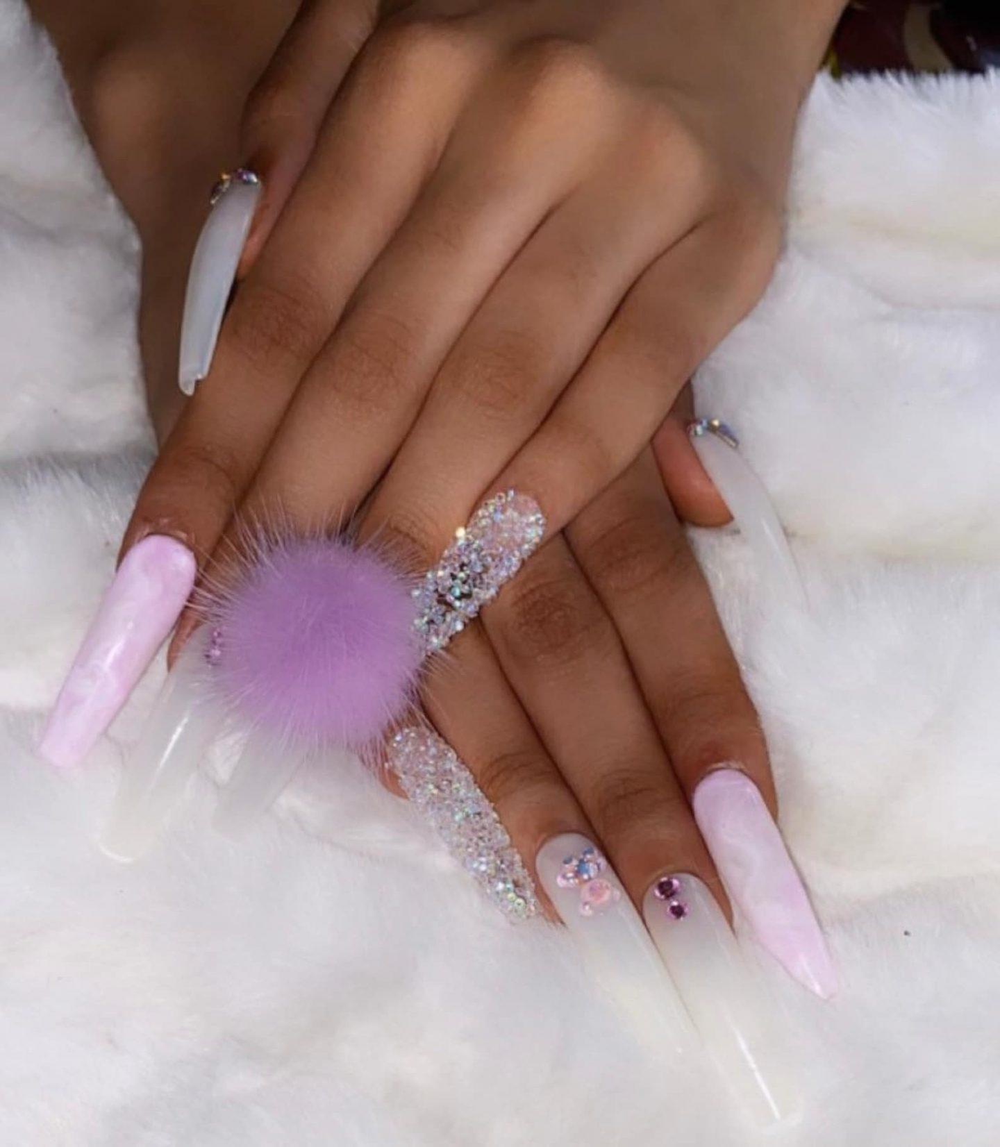 Light purple pom pom nails with rhinestones