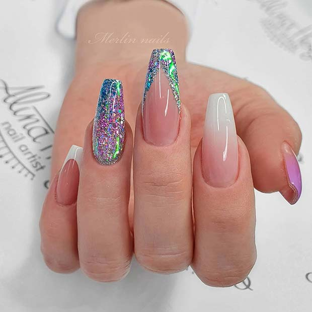 Cute birthday nails with purple and blue holographic glitter and French tips