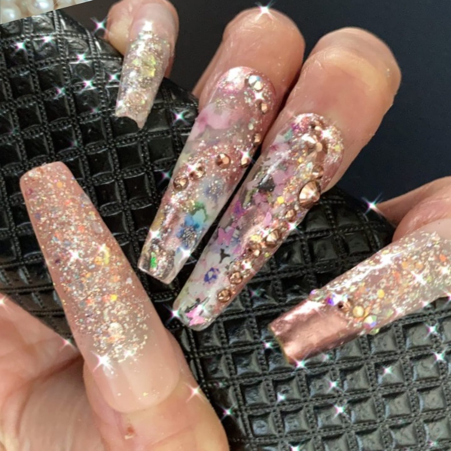 Glam long nude nails with glitter and rhinestones